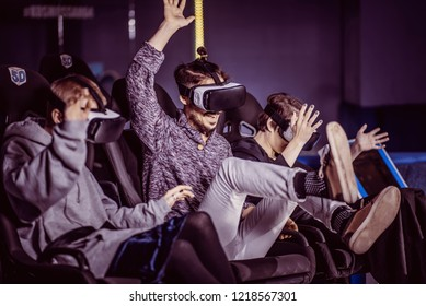 friends in virtual glasses watching movies in the cinema with special effects