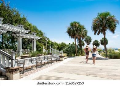 Friends walking to the beach on summer trip. Girls enjoying vacation together. Coligny Beach Park, Hilton Head Island, South Carolina, USA
