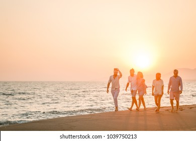 Friends Walking on the Beach