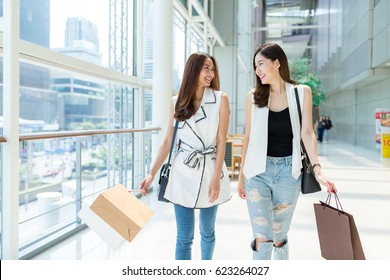 Friends walking in shopping mall