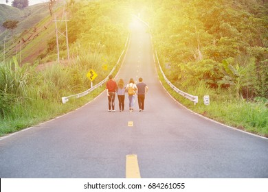 Friends walking together on long straight road,Business partner,Goal concept