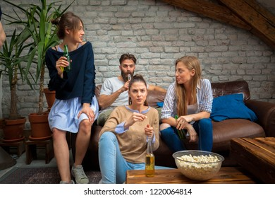 Friends watching football game