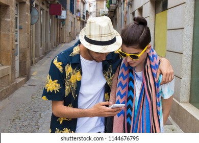 friends watching the mobile phone on the street
