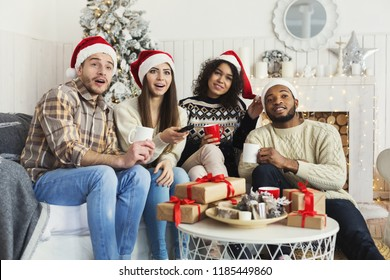 Friends watching movie and having fun together on Christmas eve, copy space