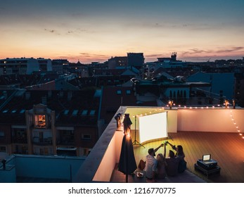 Friends watching movie at rooftop