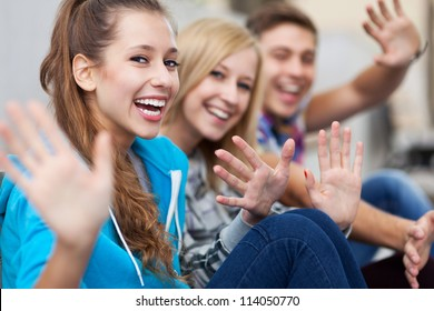 Friends waving