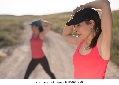 Friends woman preparing for outdoors run training in spring day