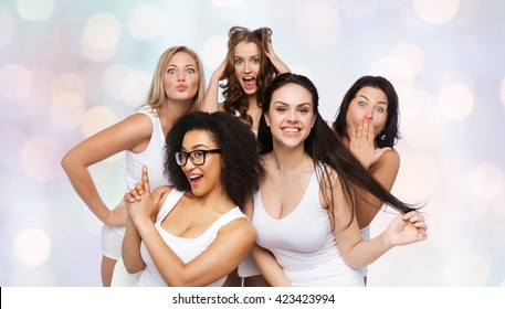 friendship, beauty, body positive and people concept - group of happy plus size women in white underwear having fun and making faces over holidays lights background