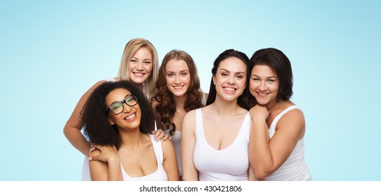 friendship, beauty, body positive and people concept - group of different happy women in white underwear over blue background