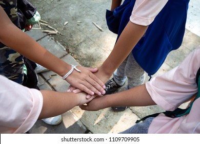 Friendship between friends. Be harmonious. Collaborate together to achieve the goal. True friends are ready to help each other.