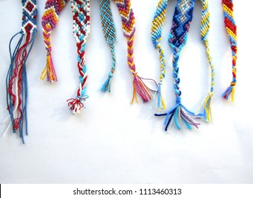 friendship bracelets made of thread with braids on white background