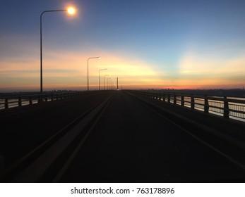 Friendship bridge mekong river Mukdahan-Swannaket Thailand & Laos sunset