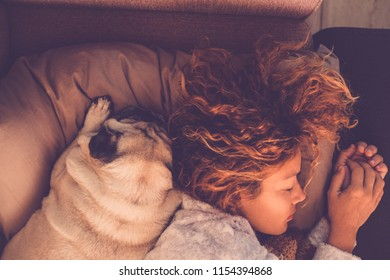 friendship concepts for 40s woman sleeping with her best firends pug dog at home. Both on the pillow and brown warm tones. Dreaming together. Love and friendship image mood