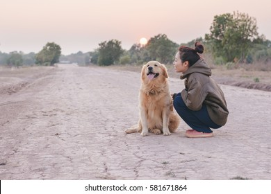 Friendship Girl playing with dog