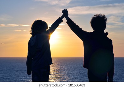 Friendship and hands in the air on sunset