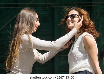 Friendship, never ends. Two attractive beautiful young woman. Candid outdoor shot Girls having fun. Couple Tenderness