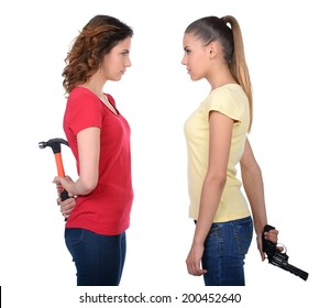 Friendship is over. Two angry women standing back to back and holding their arms crossed while isolated on white
