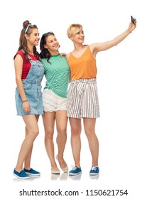 friendship and people concept - group of happy female smiling friends taking selfie by smartphone over white background