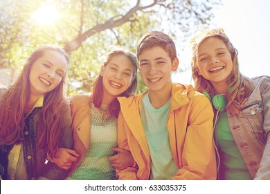 friendship and people concept - group of happy teenage students or friends outdoors