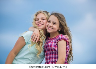 friendship and sisterhood concept. small girls embrace outdoor. autumn season. happy childrens day. love my family. small girl are school friends. Good mood at any weather.