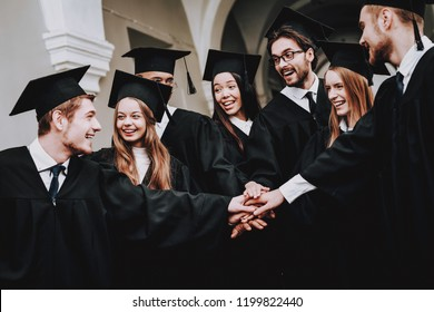 Friendship. Standing. Corridor. University. Group of Students. Mantles. Young People. Sit. Freelance. Knowledge. Architecture. University. Students. Study Together. Good Mood. Have Fun.