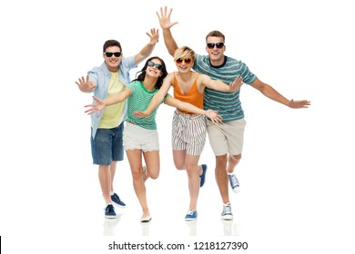 friendship, summer and people concept - group of happy smiling friends in sunglasses having fun over white background