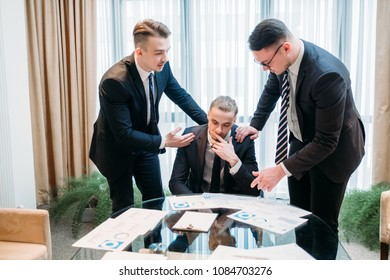 friendship support help sympathy compassion concept. business partners or colleagues consoling and comforting their distressed and devastated coworker