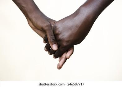 Friendship Symbol: Black People Holding Hands Together