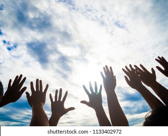 Friendship, Teamwork concept with a lot of hands raise to the sky.