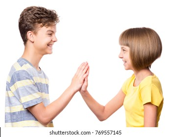 Friendship teen boy and girl are banging their palms. Portrait of happy brother and sister palm bump isolated on white background. Funny couple children gesturing and greeting.