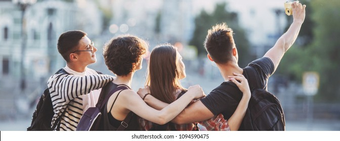 Friendship, togetherness, traveling, vacation, holidays, adventure sightseeing city tour Happy friends taking selfie together