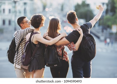 Friendship, togetherness, traveling, vacation, holidays, sightseeing city tour Happy friends taking selfie together