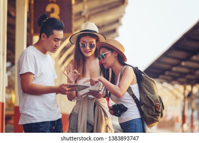 friendship, travel, vacation,Group of happy enjoy friends traveling at train station.Together concept