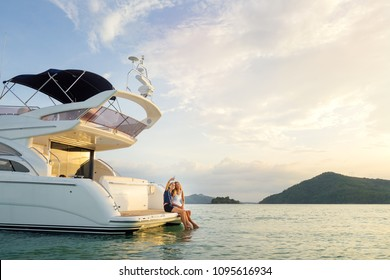Friendship and vacation.  Young pretty women taking selfie togetherr on the yacht sailing the sea.