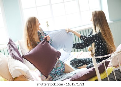 Friendship. Women in bed together