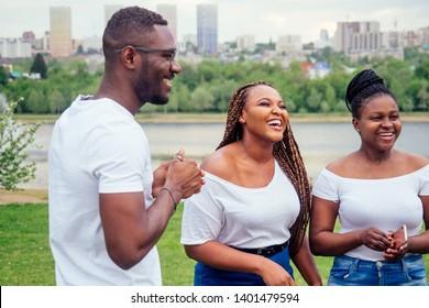friendship young millennial multi-ethnic afro braids dreadlocks friends talking spending weekend together autumn cloudy evening