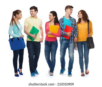 friendship, youth, education and people - group of smiling teenagers with folders and bags