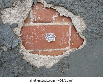 Fries before guys sticker on a brick wall