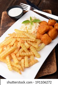 Fries with chicken nuggets and salad
