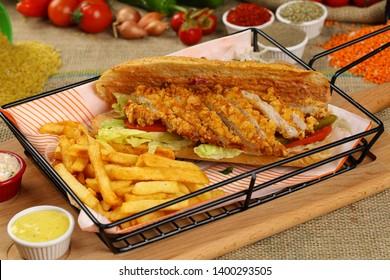 Fries chicken schnitzel and vegetable in baguette bread
