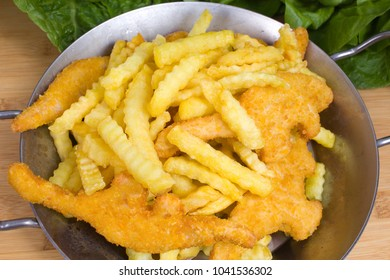 Fries and nuggets served in a pan