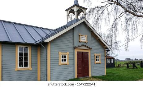 Friesland, Netherlands - December 29, 2019: A traditional historic wooden church with bell tower in a small village in Friesland.