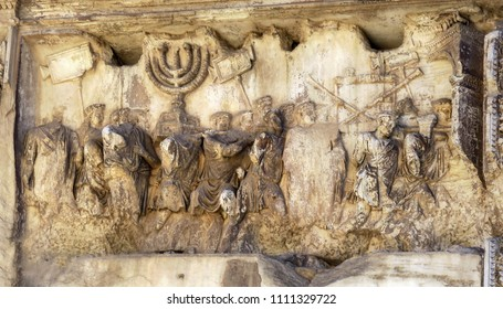 frieze celebrating the destruction of the temple in jerusalem, with the victors carrying the stolen menorah and with prisoners,  on the Palatine Hill, in downtown Rome, Italy.  March 16, 2018