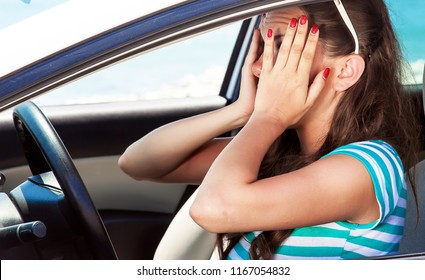Fright face of woman in the car. She is scared and shocked by driving car