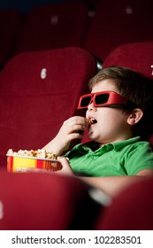 Frightened boy in 3D movie side view