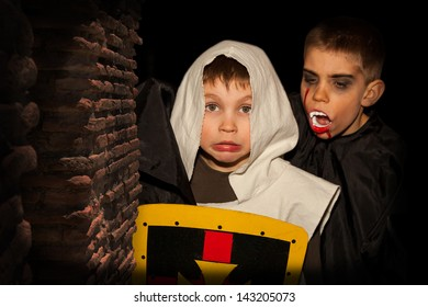 Frightened boy dressed as a knight