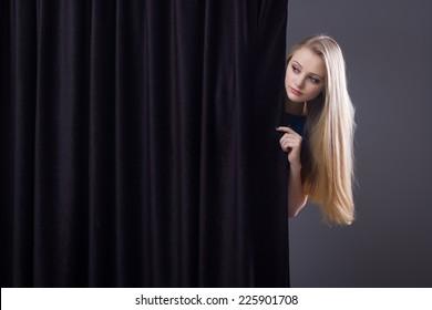 Thế giới Tình yêu - Page 2 Frightened-girl-hiding-behind-curtain-260nw-225901708