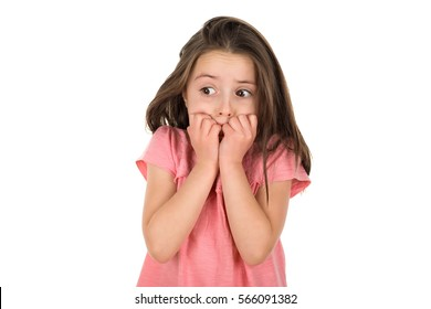 Frightened girl looking at something that scared her. Isolated on a white background