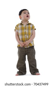 frightened little boy looking up, isolated on white background