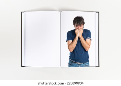 Frightened man printed on book